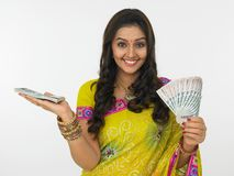 Woman with currency notes Royalty Free Stock Photography