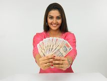 Woman with currency notes. An attractive asian woman with currency notes royalty free stock photography