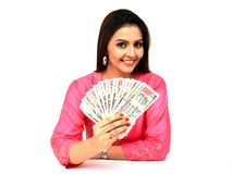 Woman with currency notes. Young origin asian woman with indian currency notes stock images
