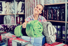 Woman customer buying new blanket and coverlet Stock Image