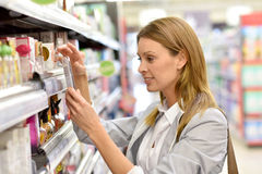 Woman customer at grocery store Stock Photos