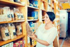 Woman customer with macaroni Royalty Free Stock Photos