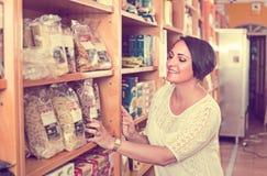Woman customer with pasta Stock Photo