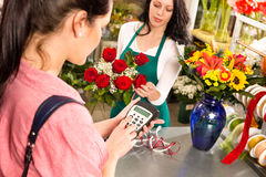 Woman customer paying flowers shop credit card Royalty Free Stock Images