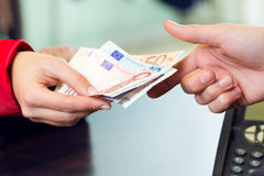 Woman customer paying with money. Hands detail. Stock Image