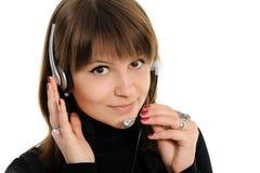 Woman customer service representative. Young female customer service representative in headset Royalty Free Stock Photo