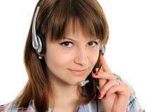 Woman customer service representative. Young female customer service representative in headset Stock Photos