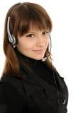 Woman customer service representative. Young female customer service representative in headset Stock Photography