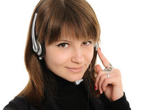 Woman customer service representative. Young female customer service representative in headset Royalty Free Stock Images