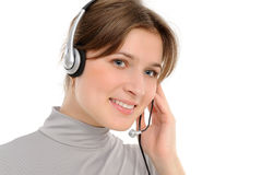 Woman customer service representative in headse. Young female customer service representative in headset, smiling  on a white background Stock Photo