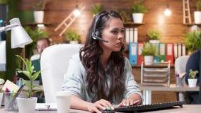 Woman customer support representative talks using the headset