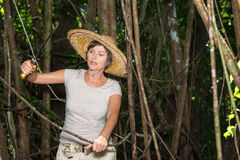 Woman cut the branch  in tropical forest Royalty Free Stock Image