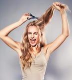 Woman cut her hair royalty free stock photos