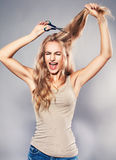 Woman cut her long hair Royalty Free Stock Photography