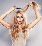 Woman cut her long hair. Woman cut her hair. Problem of split ends Stock Photos