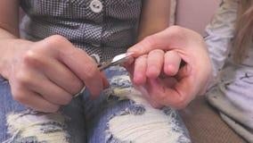Woman cut nails. LWoman cut nails in room stock video