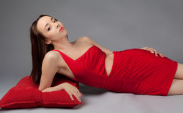 Woman In Cut Out Red Dress Stock Image