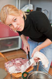 Woman cut pork meat Stock Image