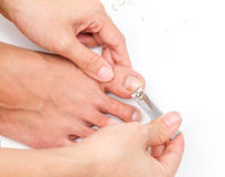 Woman cut toenail with herself. Stock Images