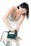 Woman cut wood plank with electric saw Royalty Free Stock Photos