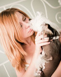 Woman with a cute little dog Stock Photography