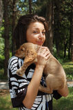 Woman with cute pet dog Royalty Free Stock Image