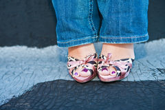 Woman in Cute Pink Heels and Blue Jeans Stock Photo
