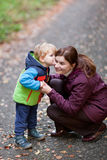 Woman and cute toddler boy in autumn forest Stock Photo