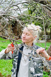 Woman cuts a branch at an Apple-tree in the garden Royalty Free Stock Photos