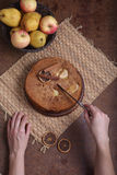 The woman cuts a charlotte with apples Stock Images