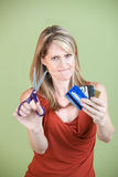 Woman Cuts Credit Cards Royalty Free Stock Image