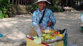 Woman cuts fruit. stock video