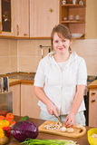 The woman cuts mushrooms Royalty Free Stock Photos