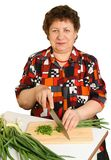 Woman cuts vegetables Stock Photos