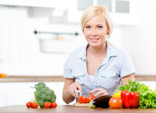 Woman cuts vegetables for salad Royalty Free Stock Images