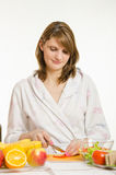 Woman cuts vegetables for salads Royalty Free Stock Photography