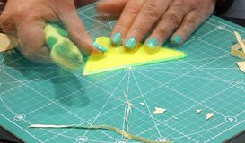 Woman cuts on the worktable. Hand of woman cuts on the worktable Royalty Free Stock Photography