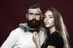 Woman cuttin male beard Stock Photography