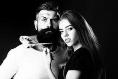 Woman cuttin male beard Stock Image