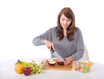 Woman Cutting An Apple Royalty Free Stock Image