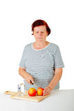 Woman cutting apples Royalty Free Stock Images