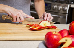 Woman cutting apples Stock Image