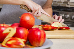 Woman cutting apples Royalty Free Stock Image