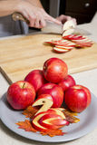 Woman cutting apples Stock Photography