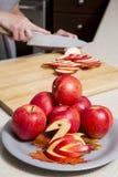 Woman cutting apples Stock Photo