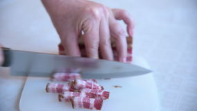 Woman cutting bacon stock footage