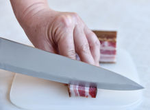 Woman cutting bacon Royalty Free Stock Photo