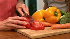 Woman cutting bell pepper stock footage