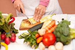 Woman cutting bell pepper on slices Royalty Free Stock Photo