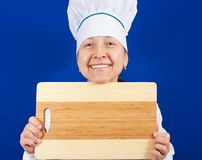 Woman with cutting board Royalty Free Stock Photography